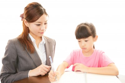 home tuition teacher teaching kid